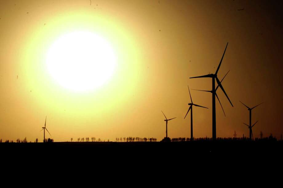 Among China's energy assets is the Dingbian Fanshigou wind power plant. China topped the list of global investments in clean energy in 2012. Photo: Liu Xiao, SUB / AP2010