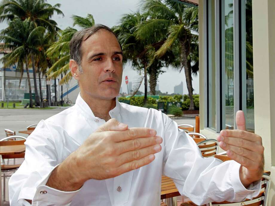 FILE -This March 7, 2012 file photo shows Fane Lozman talking to a reporter in Miami Beach, Fla. The Supreme Court says a Florida man's floating home was a house, not a boat, and not covered under maritime law. The high court on Tuesday ruled 7-2 for Lozman, who argued that his gray, two-story vessel in the marina in Riviera Beach, Fla., should not have been affected by maritime law.  (AP Photo/Alan Diaz, File) Photo: Alan Diaz, STF / AP