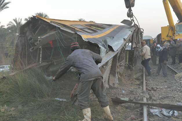 Crain remove the wreckage of a train in the Giza in Badrashin, about 40 km south of Cairo, on January 15, 2013, at least 19 people where killed and injured 105. The train carrying conscripts from south Egypt to Cairo derailed in the Giza neighbourhood of Badrasheen, state media reported. Giza governor Ali Abdelrahman said emergency services were at the scene and ambulances were ferrying the injured to hospital. The accident is the latest in a string of transport disasters plaguing the country.    AFP PHOTO / KHALED DESOUKIKHALED DESOUKI/AFP/Getty Images Photo: Khaled Desouki, AFP/Getty Images
