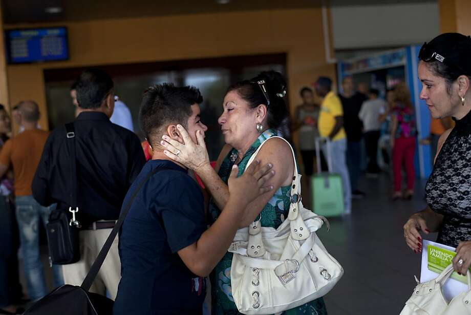 Ivan Lee, 12, says goodbye to a family member before traveling to Miami to reunite with his mother. Photo: Ramon Espinosa, Associated Press