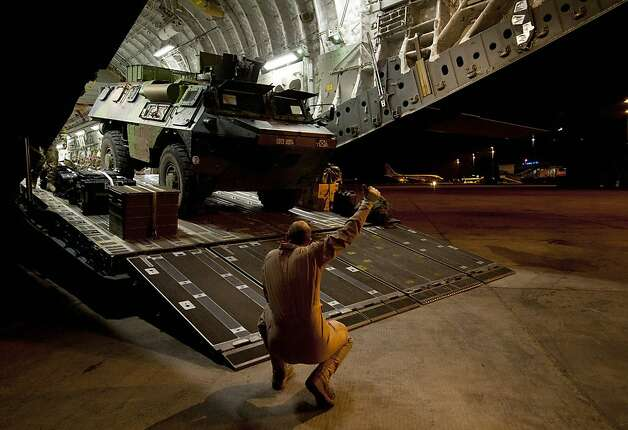 A French armored vehicle exits a British C-17 transport plane at the Bamako airport in Mali. Photo: Sac Dek Traylor, AFP/Getty Images
