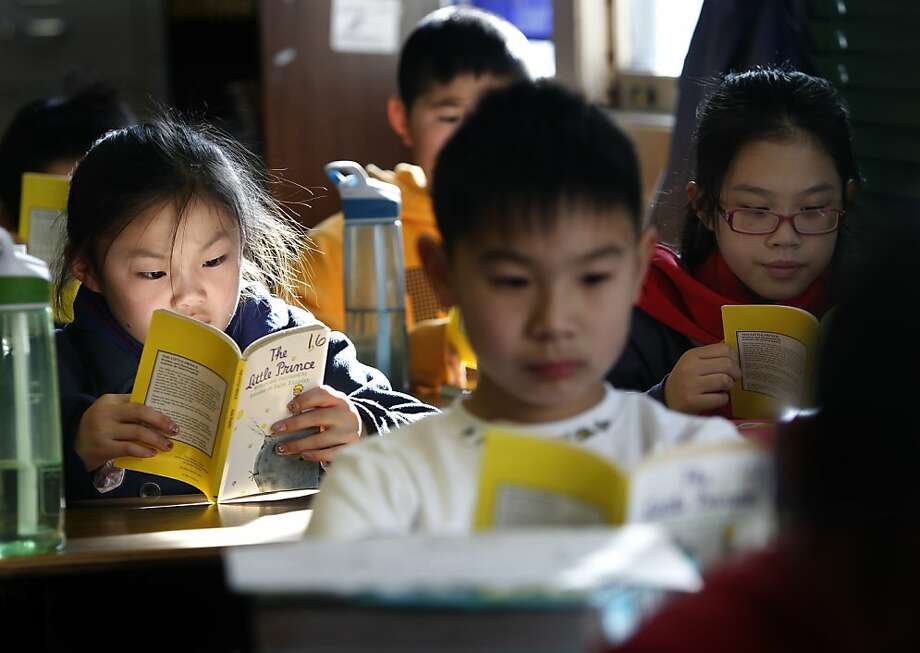 "Jasmine Louie (left), Ivan Chen and Kelly Liu read ""The Little Prince"" at John Yehall Chin Elementary in San Francisco. Photo: Paul Chinn, The Chronicle"