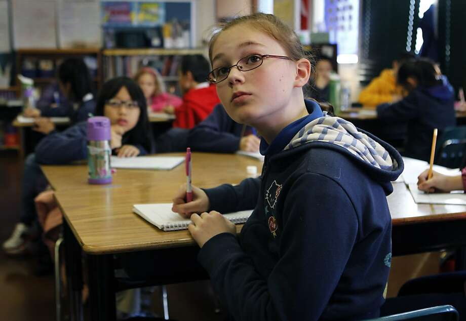 Charlotte Webster takes notes in Melissa Thormahlen's 4th and 5th grade class at John Yehall Chin Elementary School in San Francisco, Calif. on Tuesday, Jan. 15, 2013. Photo: Paul Chinn, The Chronicle