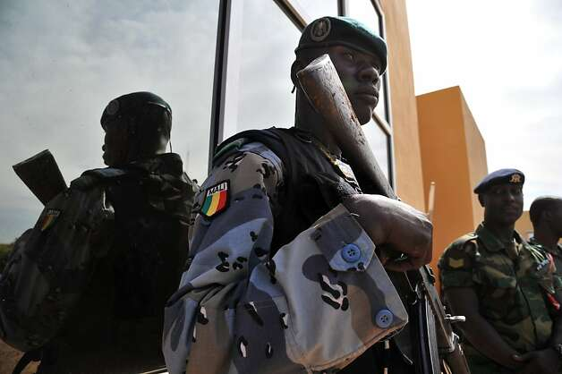 TOPSHOTS Malian gendarmes stand guard during a meeting by ECOWAS chiefs of staff on January 15, 2013  in Bamako.  West African army chiefs met in Bamako on Tuesday on plans to send African troops to join an offensive against Islamists occupying northern Mali, as France pressed on with air strikes against the insurgents.AFP PHOTO / ISSOUF SANOGOISSOUF SANOGO/AFP/Getty Images Photo: Issouf Sanogo, AFP/Getty Images
