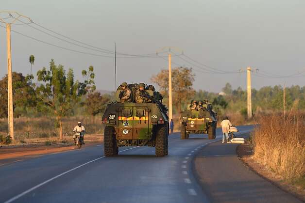 "French army soldiers stand on armoured vehicles as they leave Bamako and start their deployment to the north of Mali as part of the ""Serval"" operations on January 15, 2013 . France is using air and ground power in a joint offensive with Malian soldiers launched on January 11 against hardline Islamist groups controlling northern Mali.  AFP PHOTO /ERIC FEFERBERGERIC FEFERBERG/AFP/Getty Images Photo: Eric Feferberg, AFP/Getty Images"