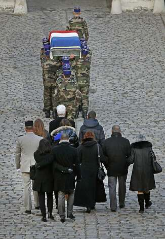 Relatives follow the coffin of French army lieutenant Damien Boiteux who was killed during a mission in Mali, at the end of a repatriation ceremony at the Invalides in Paris, Tuesday Jan. 15, 2013.  The French pilot died while taking part Friday afternoon in an aerial operation targeting a terrorist group moving on the town of Mopti. (AP Photo/Remy de la Mauviniere) Photo: Remy De La Mauviniere, Associated Press