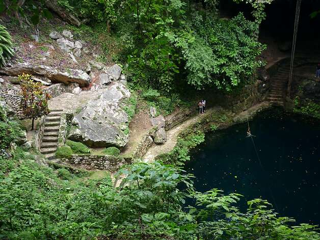 Cenote Zaci is located in the middle of town. With easily navigable stepped trail passes caves, stalactites, hanging vines,  and more fresh air than you'll find at Cenote Dzitnup, it's definitely worth a visit.  Photo: Christine Delsol, Special To SFGate