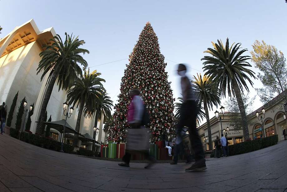 Consumers checking off names on their shopping lists boosted retail sales in December. That may change this month with higher payroll taxes kicking in. Photo: Chris Carlson, Associated Press