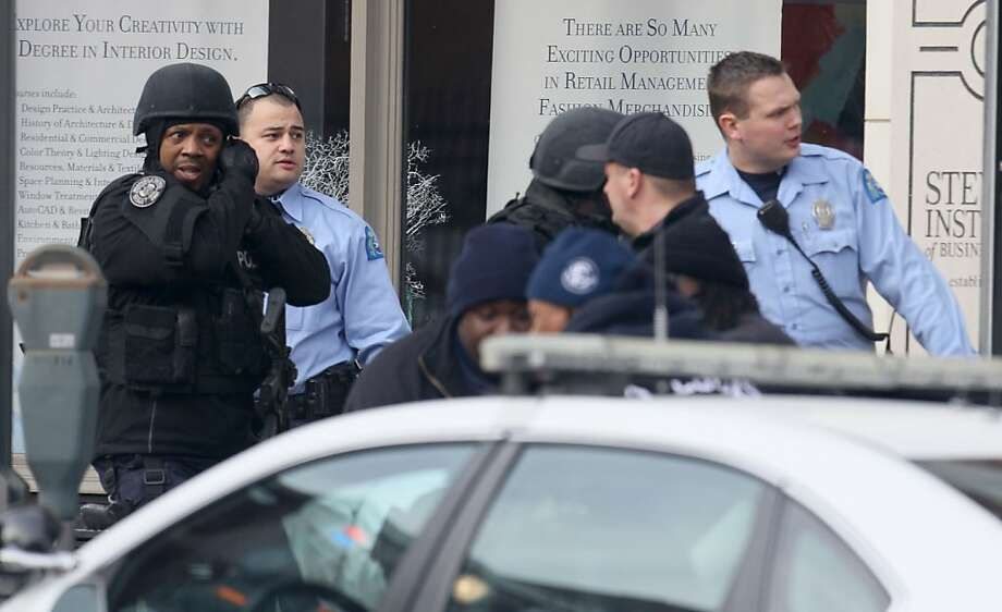 Police respond to a shooting at the Stevens Institute of Business and Arts, where a student shot and wounded a longtime administrator and himself. Photo: David Carson, Associated Press