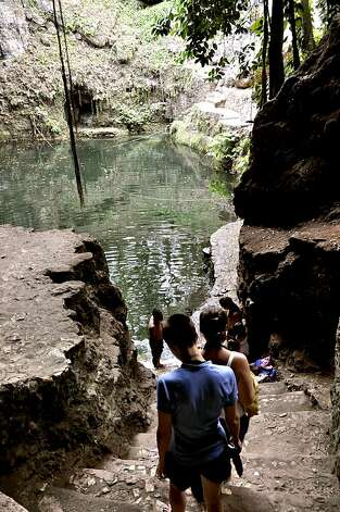 Although beautiful, Cenote Dzitnup can be rather claustrophobic. Skip the crowds and head across the road to visit the smaller Samula cenote.  Photo: Christine Delsol, Special To SFGate