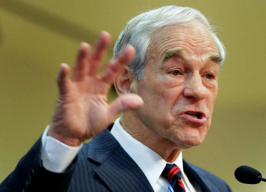 FILE - This Feb. 1, 2012 file photo shows then-Republican presidential candidate, Rep. Ron Paul, R-Texas speaking in Las Vegas. Ron Paul is exiting the political stage but his legions of rabble-rousing followers insist they are only getting started. Libertarian-leaning loyalists of the two-time Republican presidential candidate have quietly taken over key-state GOP organizations, ensuring future fights with the GOP?s establishment and laying the groundwork for a future presidential candidate.   (AP Photo/Julie Jacobson, File) Photo: Julie Jacobson, STF / AP