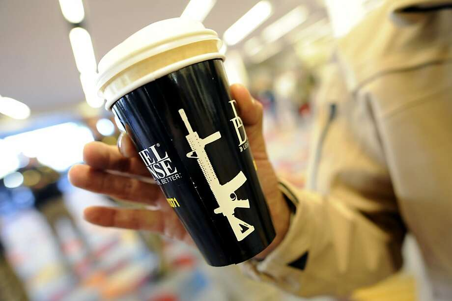 Advertising for military small arms producer Daniel Defense is seen in the form of coffee cups available to attendees.   SHOT Show, the world's largest gun show, opened at the Sands Convention Center in Las Vegas, NV on Tuesday January 15th, 2013, where an estimated 60,000 industry enthusiasts are expected to attend. Photo: Michael Short, Special To The Chronicle