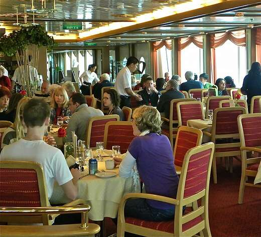 Passengers dine comfortably on board - in considerable contrast to earlier Antarctic explorers. Photo: Robert N. Jenkins, Special To The Chronicle