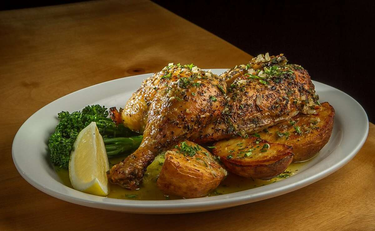 The rotisserie Chicken with Greek Potatoes and Broccolini at Orexi restaurant in San Francisco, Calif., is seen on Wednesday, January 9th, 2013.