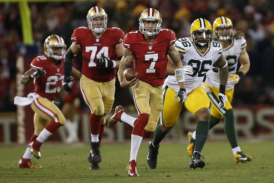 San Francisco 49ers quarterback Colin Kaepernick (7) runs the ball upfield during the second quarter of his NFL football divisional playoff game against Green Bay Packers at Candlestick Park in San Francisco, Calif. on Saturday, January 12, 2013. Photo: Stephen Lam, Special To The Chronicle