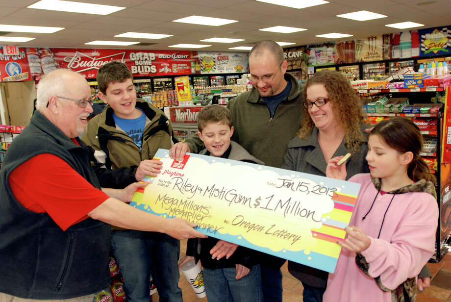 The Gunn family of Wolf Creek, Ore., had to borrow money to drive the 200 miles for the lottery check. Photo: JEFF BARNARD, STF / AP