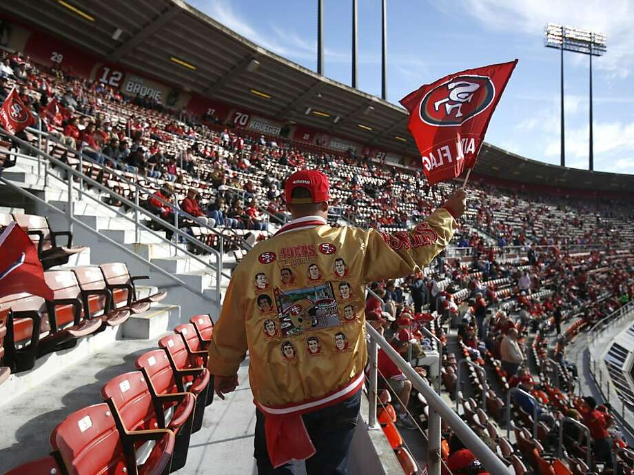 One of the 49er Faithful walks to his seat in the upper deck at Candlestick, above, a place where, even if everyone didn't know your name, at least they'd probably recognize your jacket. Photo: Stephen Lam, Special To The Chronicle