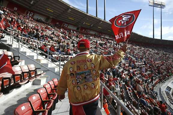 49er fan Jhan Gonzalez from Union City walks to stands before the San Francisco 49ers kick off against the Detroit Lions at Candlestick Park in San Francisco, Calif., on Sunday September 16, 2012.