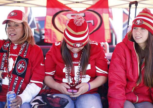 The family that tailgates together ... Leticia Grajales-Valdez (left) and daughters Letty and Gina fire up for the game against the New York Giants. Photo: Stephen Lam, Special To The Chronicle