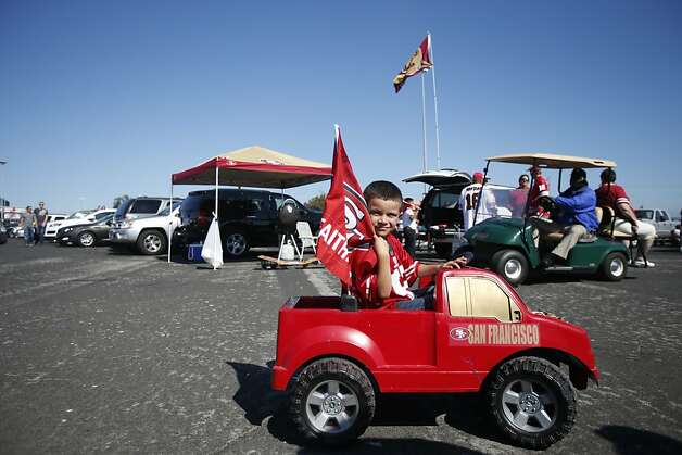 Evan Rocha, 6, of San Jose takes his 49ers mini-truck for a spin outside Candlestick before watching the home team run circles around the Bills. Photo: Stephen Lam, Special To The Chronicle