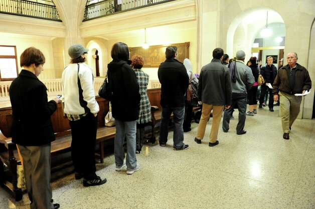 City residents wait in line for a resident parking permit on Tuesday, Jan. 15, 2013, at City Hall in Albany, N.Y. (Cindy Schultz / Times Union) Photo: Cindy Schultz / 00020764A