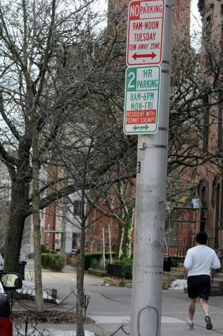 A parking sign showing resident parking only Monday thru Friday 8am-6pm on State Street between Dove St. and Swan St. on Tuesday Jan. 15, 2013 in Albany, N.Y.  After years of debate and negotiations, Albany launched its permit parking system. (Lori Van Buren / Times Union) Photo: Lori Van Buren