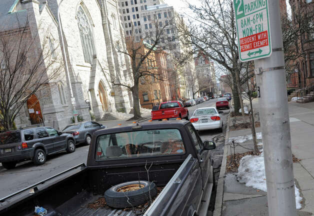 A pick up truck displays a residential parking permit in its window on State St. near Swan St. on Tuesday Jan. 15, 2013 in Albany, N.Y. After years of debate and negotiations, Albany launched its permit parking system. (Lori Van Buren / Times Union) Photo: Lori Van Buren