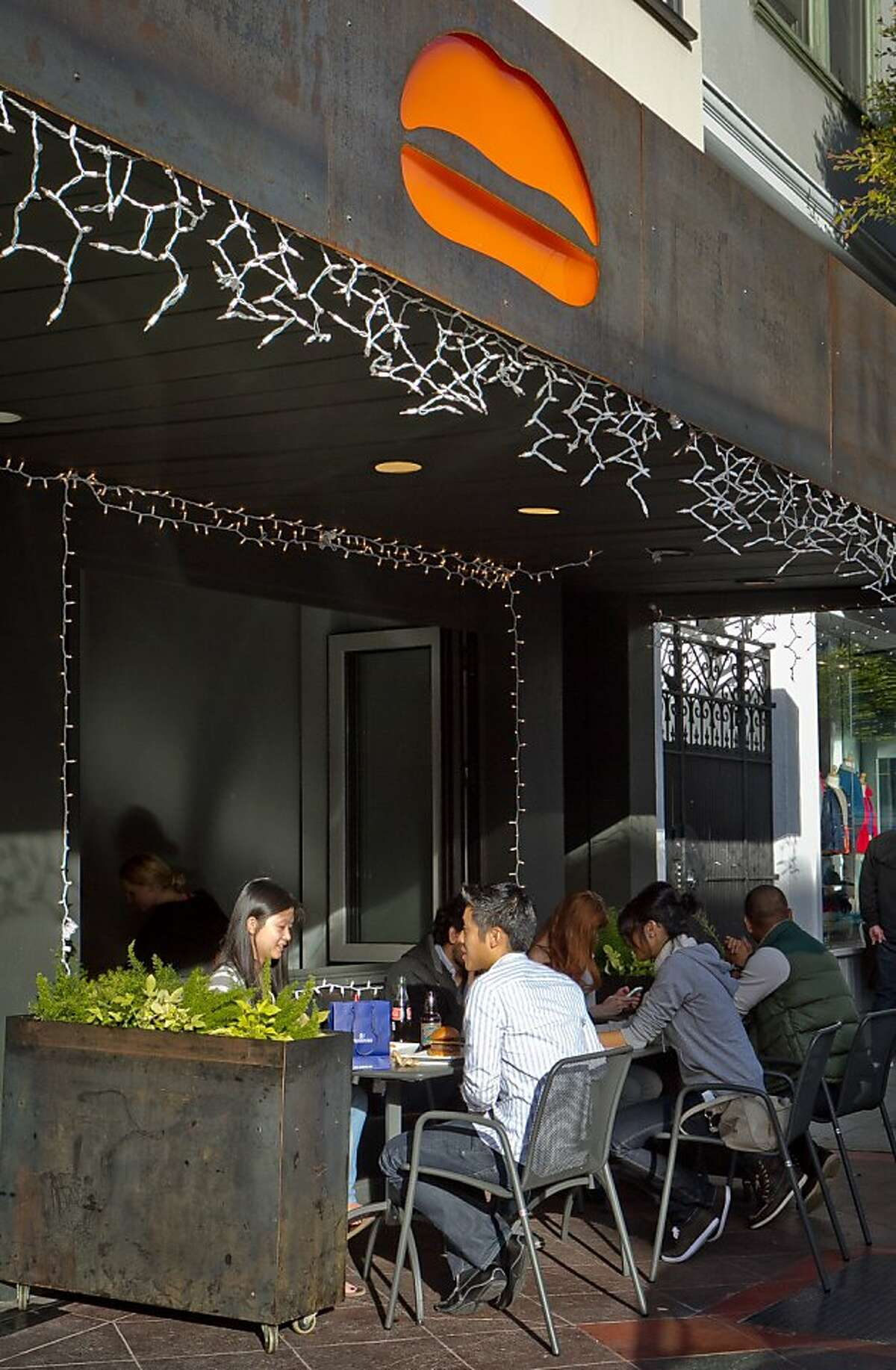Diners enjoy lunch outside at Umami Burger in San Francisco, Calif., on Sunday, January 8th, 2012.