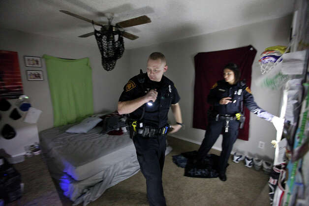 San Antonio Police Department officer Justin Remmers, one of 36 officers in SAPD's Tac Medic unit, (left) and San Antonio Police Department officer Cathleen Garcia respond to a disturbance call Friday Dec. 21, 2012.  The Tac Medic program has been credited with saving at least 20 of the more than 300 patients the officers have treated. Photo: Edward A. Ornelas, San Antonio Express-News / © 2012 San Antonio Express-News