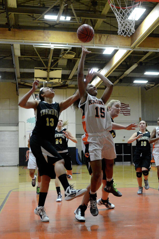 Stamford #15 Ansia Fortt goes up for two ahead of Trumbull #13 Joyce Woolen as Stamford High School hosts Trumbull High School in girls varsity basketball in Stamford, CT on Jan. 15, 2013. Photo: Shelley Cryan / Shelley Cryan for the Stamford Advocate/ freelance Shelley Cryan