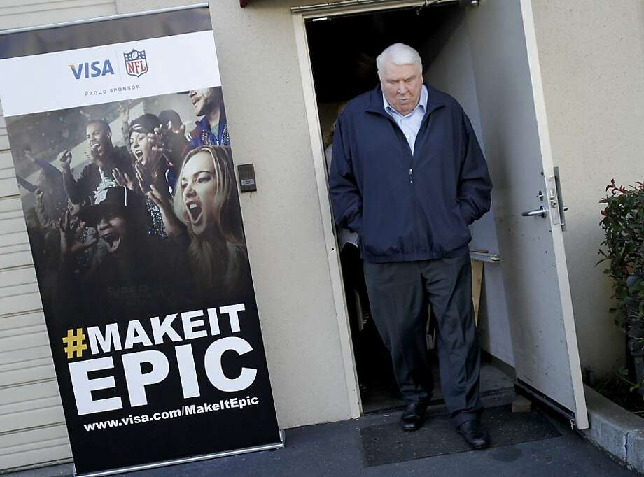 John Madden walked past a publicity poster for an upcoming VISA event at his Pleasanton offices. John Madden, the former Oakland Raiders coach, and television personality talked about the 49ers and the upcoming playoff game at his offices in Pleasanton, Calif. Tuesday January 15, 2013. Photo: Brant Ward, The Chronicle