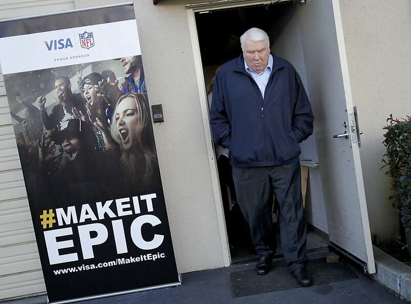 John Madden walked past a publicity poster for an upcoming VISA event at his Pleasanton offices. Joh