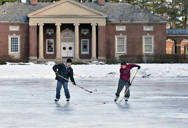 Marcus Piscitelli, left, of Saratoga Springs, and John Lansburg of Ballston Spa run hockey drills on the skating rink at Saratoga Spa State Park Tuesday Jan. 15, 2013.  (John Carl D'Annibale / Times Union) Photo: John Carl D'Annibale