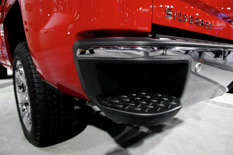 A 2014 Chevrolet Silverado with a step in the rear bumper is displayed at media previews for the North American International Auto Show in Detroit, Tuesday, Jan. 15, 2013. (AP Photo/Paul Sancya) Photo: Paul Sancya