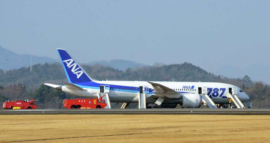 An All Nippon Airways flight sits at Takamatsu airport in Takamatsu, western Japan after it made an emergency landing Wednesday, Jan. 16, 2013. The flight to Tokyo from Ube in western Japan landed at the airport after a cockpit message showed battery problems, in the latest trouble for the Boeing 787 ?Dreamliner.? (AP Photo/Kyodo News) JAPAN OUT, MANDATORY CREDIT, NO LICENSING IN CHINA, HONG KONG, JAPAN, SOUTH KOREA AND FRANCE Photo: SUB / Kyodo News
