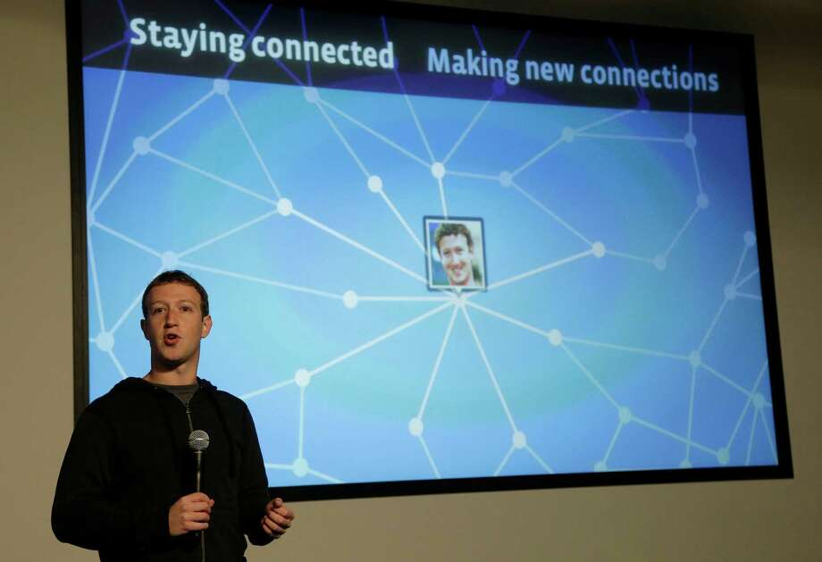 Facebook CEO Mark Zuckerberg speaks about Facebook Graph Search at a Facebook headquarters in Menlo Park, Calif., Tuesday, Jan. 15, 2013.  The new service lets users search their social connections for information about their friends' interests, and for photos and places.  (AP Photo/Jeff Chiu) Photo: Jeff Chiu
