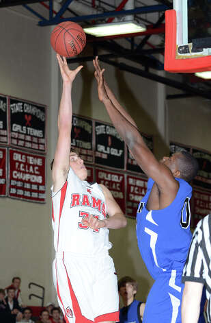 New Canaan's Zachary Allen (34) goes for a shot against Darien's Chima Azuonwu (0) during the boys basketball at New Canaan High School on Tuesday, Jan. 15, 2013. Photo: Amy Mortensen / Connecticut Post Freelance