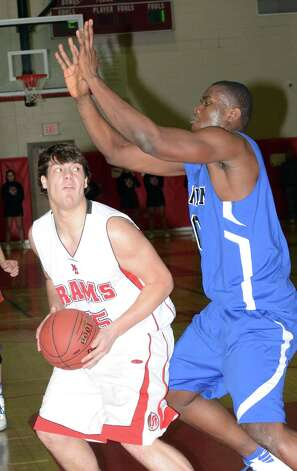 New Canaan's Beau Santero (35) controls the ball as Darien's Chima Azuonwu (0) defends during the boys basketball at New Canaan High School on Tuesday, Jan. 15, 2013. Photo: Amy Mortensen / Connecticut Post Freelance