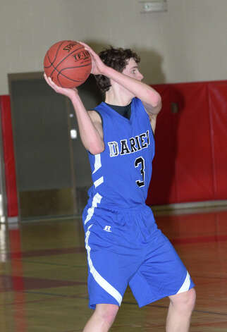 Darien's George Phillips (3) looks to pass during the boys basketball against New Canaan High School at New Canaan High School on Tuesday, Jan. 15, 2013. Photo: Amy Mortensen / Connecticut Post Freelance