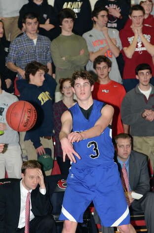 Darien's George Phillips (3) passes the ball during the boys basketball against New Canaan High School at New Canaan High School on Tuesday, Jan. 15, 2013. Photo: Amy Mortensen / Connecticut Post Freelance