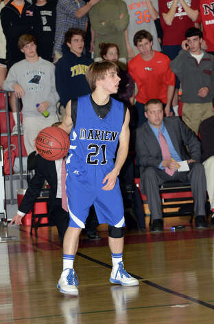 Darien's Matt Staubi (21) controls the ball during the boys basketball against New Canaan High School at New Canaan High School on Tuesday, Jan. 15, 2013. Photo: Amy Mortensen / Connecticut Post Freelance