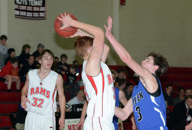 Darien's George Phillips (3) defends against New Canaan's Andrew Penchuck (31) during the boys basketball at New Canaan High School on Tuesday, Jan. 15, 2013. Photo: Amy Mortensen / Connecticut Post Freelance