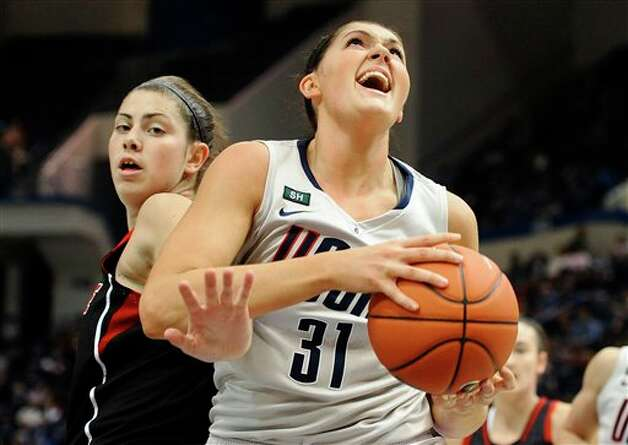 UConn's Stefanie Dolson, left, is guarded by Louisville's Sara Hammond, left, during the first half of an NCAA college basketball game in Hartford, Conn., Tuesday, Jan. 15, 2013. (AP Photo/Jessica Hill)