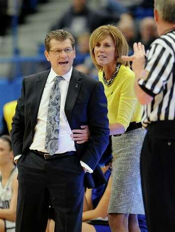 UConn head coach Geno Auriemma, left, is held back by associate head coach Chris Dailey, center, as he argues a call with an official during the first half of an NCAA college basketball game in Hartford, Conn., Tuesday, Jan. 15, 2013. (AP Photo/Jessica Hill)