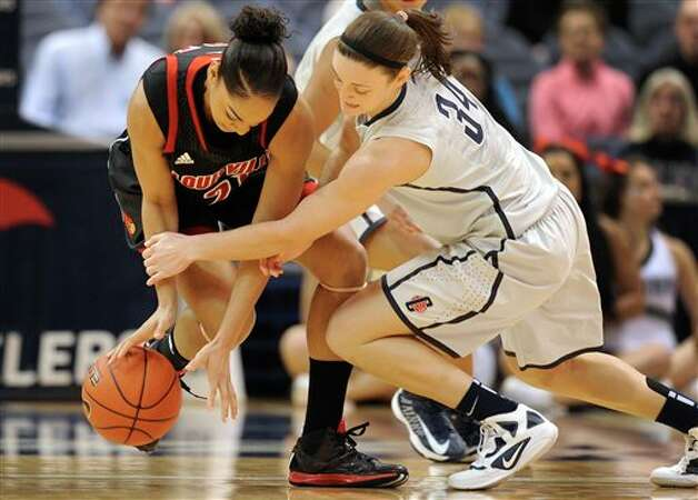 UConn's Kelly Faris, right, pressures Louisville's Bria Smith, left, during the first half of an NCAA college basketball game in Hartford, Conn., Tuesday, Jan. 15, 2013. (AP Photo/Jessica Hill)