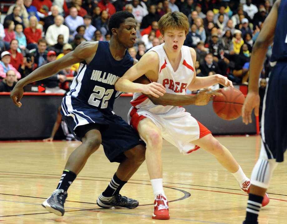 Hillhouse's #22 Shane Christie tries to steal away the ball from Fairfield Prep's #5 Tommy Nolan, during boys basketball action at Alumni Hall at Fairfield University in Fairfield, Conn. on Tuesday January 15, 2013. Photo: Christian Abraham / Connecticut Post