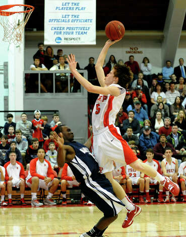 Fairfield Prep's #5 Tommy Nolan leaps to the net at he knocks into Hillhouse's #5 Marcus Brown, during boys basketball action at Alumni Hall at Fairfield University in Fairfield, Conn. on Tuesday January 15, 2013. Photo: Christian Abraham / Connecticut Post
