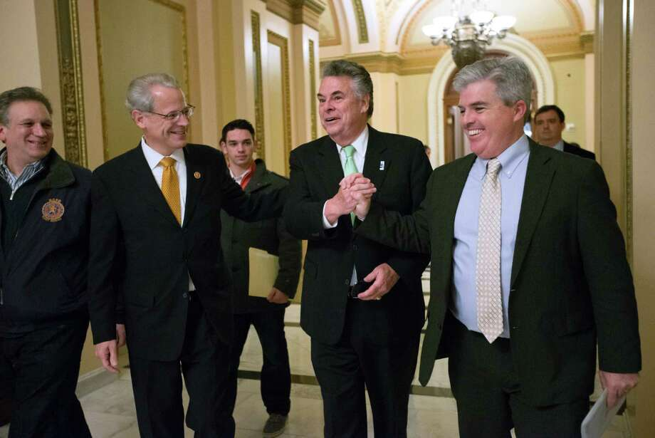 From right, Suffolk County, N.Y., Executive Steve Bellone, Rep. Peter King, R-N.Y., Rep. Steve Israel, D-NY, and Nassau County Executive Edward P. Mangano, celebrate just after the House of Representatives passed a $50.7 billion emergency aid bill for states hit by Superstorm Sandy, Tuesday, Jan. 15, 2013, at the Capitol in Washington. (AP Photo/J. Scott Applewhite) Photo: J. Scott Applewhite