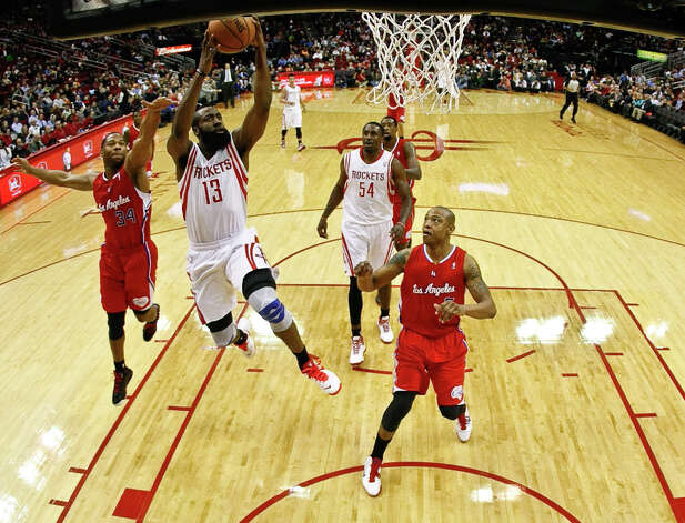 Jan. 15: Clippers 117, Rockets 109Rockets guard James Harden breaks away from Clippers guard Willie Green for a basket. Photo: Nick De La Torre / © 2013  Houston Chronicle