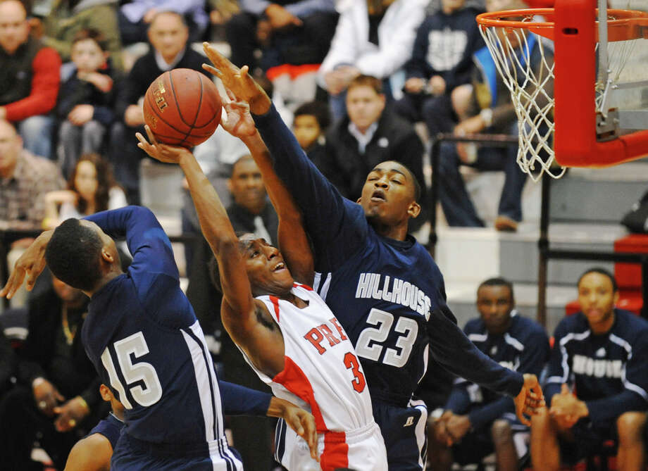 Fairfield Prep's #3 Keith Pettway is blocked by Hillhouse's #23 Requan Clark and #15 Quaraun Sturges, left, during boys basketball action at Alumni Hall at Fairfield University in Fairfield, Conn. on Tuesday January 15, 2013. Photo: Christian Abraham / Connecticut Post